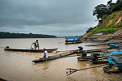 NO WEB/NO APPS - Exclusive. (Text available) Fishermen on their canoes at the port of 'Palma Real' native community, near Puerto Maldonado, Peru on July 17, 2017. The Amazon rainforest is famous as 'The Lung of the Earth', but also for the presence of numerous native communities, who have always lived isolated and in close contact with nature for generations, used to seek for food and medicines and to build items directly from the environment in which they live. The unstoppable rise of globalization has drastically changed their needs, expectations and consequently their way of life. Located in the Tambopata National Reserve, on the border between Peru and Bolivia, the native Comunidad Palma Real is one of the clearest examples of this change. Living on the banks of the Madre de Dios River since approximately 1976, Palma Real comprises about 300 people part of the nomadic community Ese-Eja, established in the Amazon rainforest of Peru before the Spanish colonization. Photo by Giacomo d'Orlando/ABACAPRESS.COM