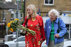 © Licensed to London News Pictures. 16/06/2017. Birstall, UK. The current MP for Batley and Spen Tracy Brabin lays flowers in Birstall market place where Labour MP Jo Cox was murdered a year ago today. Events are planned to take place across the country this weekend in memory of Jo Cox in what is being called 'The Great Get Together'. Credit: Ian Hinchliffe Photo credit : Ian Hinchliffe/LNP
