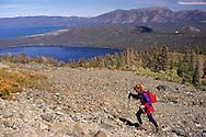 Female hiker on rocky mountain slope, Mount Tallac, near Lake Tahoe, California
