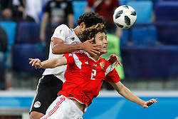 June 19, 2018 - Saint Petersburg, Russia - Mario Fernandes (R) of Russia national team vies for a header with Marwan Mohsen of Egypt national team during the 2018 FIFA World Cup Russia group A match between Russia and Egypt on June 19, 2018 at Saint Petersburg Stadium in Saint Petersburg, Russia. (Credit Image: © Mike Kireev/NurPhoto via ZUMA Press)