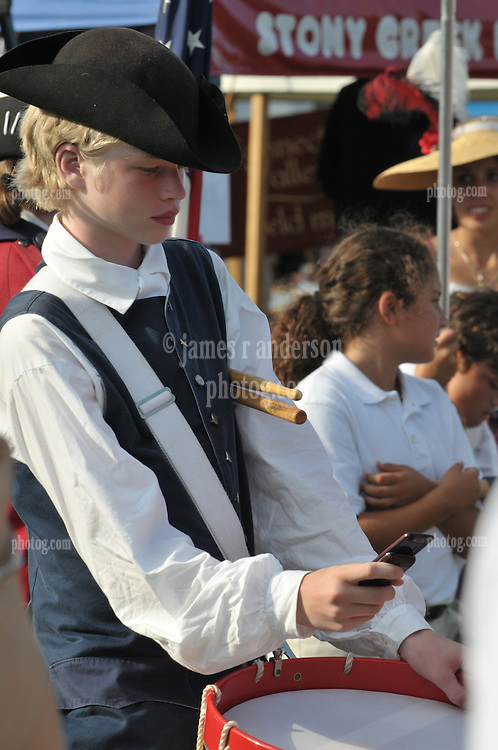 Drummer Boy checking his text messages in a Tricorn Hat. At The Deep River Ancient Muster and Parade, 18 July 2009, in Deep River, Connecticut