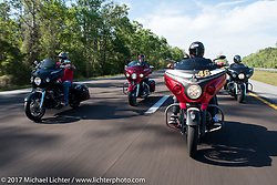 Motorcycle Racer Carey Hart riding a personally customized Indian Chieftain with Marc Altieri (l) and Bagger Magazine's Morgan Gales (r) riding 2017 Indian Chieftains and AJ Smyth of Indian (2nd from l) riding a 2017 Chieftan Elite on I-95 during Daytona Beach Bike Week. FL, USA. Friday March 10, 2017. Photography ©2017 Michael Lichter.
