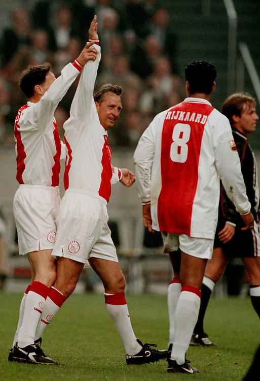 Photo: Gerrit de Heus. Amsterdam. 06/04/99. Johan Cruijff(m) an Marco van Basten celebrating a goal. Cruijff played with and against former Ajax-Players. Keywords: Cruyff