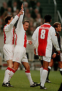 Photo: Gerrit de Heus. Amsterdam. 06/04/99. Johan Cruijff(m) an Marco van Basten celebrating a goal. Cruijff played with and against former Ajax-Players. Keywords: Cruyff