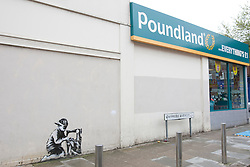 © licensed to London News Pictures. London, UK 15/05/2012. Banksy graffiti  in Turnpike Lane, north London, today (15/05/12). The graffiti has been vandalised. Union jack flags attached to the graffiti have been removed. Photo credit: Tolga Akmen/LNP