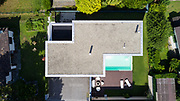 Exterior modern white villa with pool and garden, nobody inside. Aerial view from above