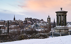 Edinburgh, Scotland, UK. 9 Feb 2021. Big freeze continues in the UK with Storm Darcy bringing several inches of snow to Edinburgh overnight. Pic; Snow flurries over skyline of Edinburgh from Calton Hill at sunrise. . Iain Masterton/Alamy Live news
