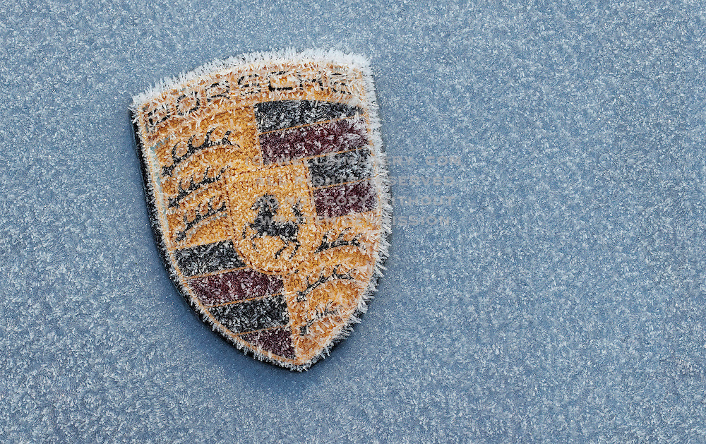 Image of a Porsche 997 hood badge in winter, Washington, Pacific Northwest by Randy Wells