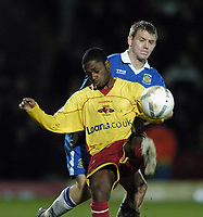 Photo: Jonathan Butler.<br />Watford v Stockport County. The FA Cup. 06/01/2007.<br />Anthony Mcnamee of Watford holds off Robert Clare of Stockport.