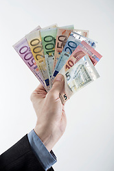 Businessman's hand showing euro banknotes, Bavaria, Germany