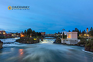 Dusk descends over Spokane Falls in Spokane, Washington, USA