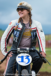 Brittany Olsen of Aberdeen, SD sits on her 1923 Harley-Davidson board track racer at the Pappy Hoel Half Mile Classic at the Sturgis Fairgrounds during the annual Sturgis Black Hills Motorcycle Rally. SD, USA. August 6, 2014.  Photography ©2014 Michael Lichter.