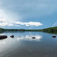 A rainbow over Willard Pond, a NH Audubon Sanctuary in Antrim, New Hampshire.