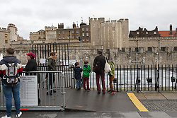 © Licensed to London News Pictures. 22/12/2015. London, UK. Disappointed visitors arrive at the Tower of London ice rink which is closed due to adverse weather. The Tower of London ice rink has been forced to close today due to safety concerns over high wind speeds.  The UK is experiencing unseasonably mild weather and high winds today. Photo credit : Vickie Flores/LNP
