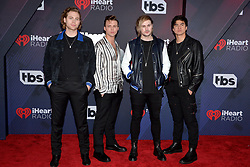 Ashton Irwin, Luke Hemmings, Michael Clifford, and Calum Hood of 5 Seconds of Summer attend the 2018 iHeartRadio Music Awards at the Forum on March 11, 2018 in Inglewood, California. Photo by Lionel Hahn/AbacaPress.com