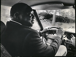 Dec. 12, 1965 - Idi Amin of Uganda in his Maserati car citrain. Credit: Cameapix. (Credit Image: © Keystone Pictures USA/ZUMAPRESS.com)
