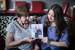 © Licensed to London News Pictures . 06/07/2017 . Manchester , UK . BARBARA DRANSFIELD and PAULA WILLIAMSON pose with a card featuring a photo of Charles Salvador on the front . Artwork by convicted criminal  Charles Salvador (previously Charles Bronson) has been sold on behalf of Salvador to raise a £1,000 to support Barbara and Len Dransfield . Barbara , who has become friendly with Salvador , was brought the money and a card by Salvador's fiance , Paula Wiliamson . Barbara Dransfield was brutally assaulted by masked robbers as she sat at home in her wheelchair . She suffered extensive injuries to her face and body . Photo credit : Joel Goodman/LNP