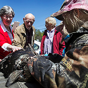 Sydney Ladeau, 10, of Hartland, right, shows off the 18-pound tom turkey she shot during the youth turkey hunting weekend to her grandparents Ruth Turgeon, 76, and Phil Turgeon, 80 in Windsor, VT.