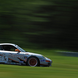 May 23, 2009; Lakeville, CT, USA; The Racers Group Porsche 997 of .Andy Lally and John Potterqualifies for the Grand-Am Koni Sports Car Challenge series competition during the Memorial Day Road Racing Classic weekend at Lime Rock Park.