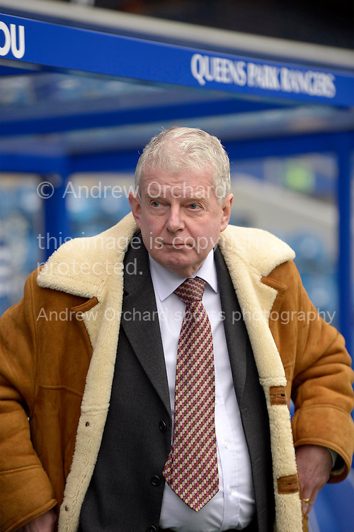 commentator John Motson looking on from the dugout before k/o. Barclays Premier league match, Queens Park Rangers v Southampton at Loftus Road in London on Saturday 7th Feb 2015. pic by John Patrick Fletcher, Andrew Orchard sports photography.