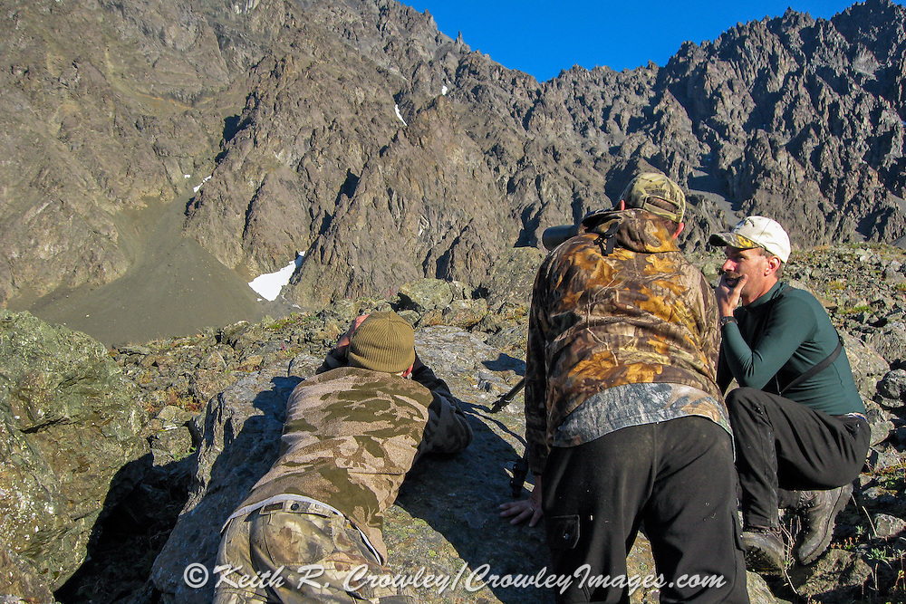 Hunters and guides judging a distant Dall ram in the Chugach Mountains of Alaska