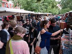 Busy weekend market at Boxhagener Square in bohemian district of Friedrichshain in Berlin