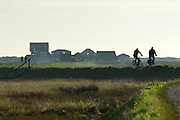 © Licensed to London News Pictures. 01/12/2013. Southwold, UK. Cyclists take advantage of the sunshine. The first of December was greeted by a brisk sunny morning at the harbour on the River Blyth in Southwold, Suffolk today, 1st December 2013. Photo credit : Stephen Simpson/LNP