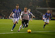 Sheffield United midfielder Mark Duffy (21) shields the ball from Sheffield Wednesday defender Tom Lees (15)  during the EFL Sky Bet Championship match between Sheffield United and Sheffield Wednesday at Bramall Lane, Sheffield, England on 9 November 2018.