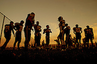 Members of the Monterey Trail High School Mustangs warm up before their game as they host the Franklin Wild Cats, Friday October 10, 2014.