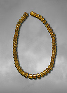 Bronze Age Hattian gold necklace from Grave L,  possibly a Bronze Age Royal grave (2500 BC to 2250 BC) - Alacahoyuk - Museum of Anatolian Civilisations, Ankara, Turkey .<br /> <br /> If you prefer to buy from our ALAMY PHOTO LIBRARY  Collection visit : https://www.alamy.com/portfolio/paul-williams-funkystock/royal-tombs-alaca-hoyuk-bronze-age.html (TIP refine search by adding background colour in the LOWER search box)<br /> <br /> Visit our ANCIENT WORLD PHOTO COLLECTIONS for more photos to download or buy as wall art prints https://funkystock.photoshelter.com/gallery-collection/Ancient-World-Art-Antiquities-Historic-Sites-Pictures-Images-of/C00006u26yqSkDOM