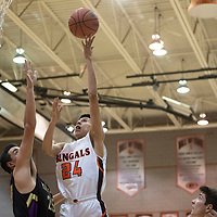 Gallup Bengal Quinn Atazhoon (24) drives to the basket in Friday night's district 1-4A tournament championship game against Kirtland Central Broncos at Gallup High School in Gallup. The Bengals beat the Broncos 60-41.