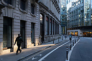 With most Londoners still working from home, a lone commuter walks on a widened Old Board Street pavement at evening rush-hour during the third lockdown of the Coronavirus in the City of London, the capitals financial district, on 26th February 2021, in London, England.