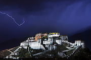 Lightning strikes over the floodlit Potala Palace during a thunderstorm in Lhasa. Once the seat of the Tibetan government and the winter residence of the Dalai Lamas.
