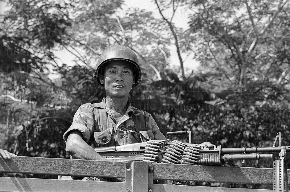 South Vietnamese army soldier takes up position in a rubber plantation as the North Vietnamese army made their advance on the city of Xuan Loc. Xuan Loc was the last major battle of the Vietnam War fought between 9th and 21st April 1975. Photographed by Terry Fincher.