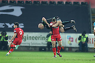 Brendon Leonard of the Ospreys is lifted up by Duncan Wier of Edinburgh rugby off the ball but is not penalised. Guinness Pro12 rugby match, Ospreys v Edinburgh Rugby at the Liberty Stadium in Swansea, South Wales on Friday 2nd December 2016.<br /> pic by Andrew Orchard, Andrew Orchard sports photography.
