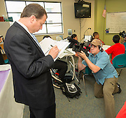 Houston ISD videographer Robert Crowe films a member of a Broad Foundation research team during a tour Ortiz Middle School, May 29, 2013.