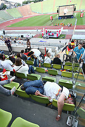 23.06.2010, Olympiapark, Muenchen, GER, FIFA Worldcup, Puplic Viewing Ghana vs Deutschland  im Bild Fan liegt auf den St¸hlen vor dem Spiel, EXPA Pictures © 2010, PhotoCredit: EXPA/ nph/  Straubmeier