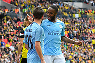 Goal - Raheem Sterling (7) of Manchester City celebrates scores a goal to give a 5-0 lead with Bernardo Silva (20) of Manchester City during the The FA Cup Final match between Manchester City and Watford at Wembley Stadium, London, England on 18 May 2019.