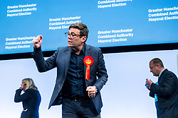 © Licensed to London News Pictures . 08/05/2021. Manchester, UK. ANDY BURNHAM pumps his fist after delivering his victory speech after being declared the winner as the results are declared at the count in the election for the Metro Mayor of Greater Manchester at the Manchester Central Convention Centre (formerly NHS Nightingale NW ). Photo credit: Joel Goodman/LNP