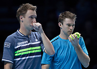 Tennis - 2017 Nitto ATP Finals at The O2 - Day One<br /> <br /> Mens Doubles: Group Eltingh/Haarhus: Henri Kontinen (Finland) & John Peers (Australia) Vs Ryan Harrison (United States) & Michael Venus (Australia)<br /> <br /> John Peers (Australia) and Henri Kontinen (Finland) pass information secretly<br /> <br /> COLORSPORT/DANIEL BEARHAM