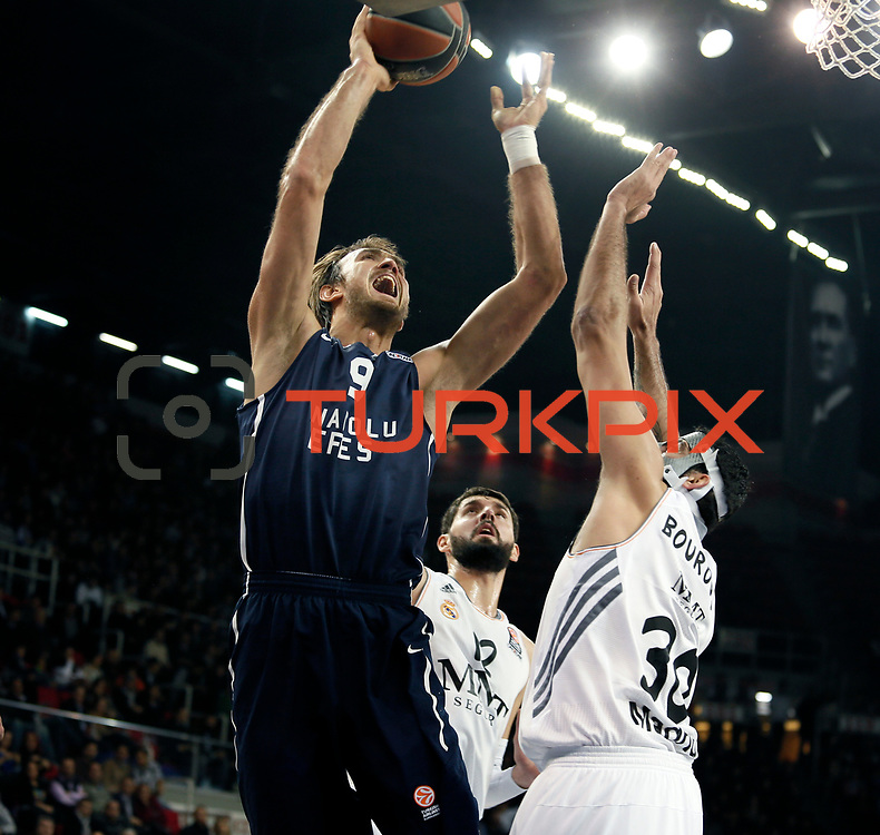 Anadolu Efes's Semih Erden (L) during their Turkish Airlines Euroleague Basketball Game 10 match Anadolu Efes between Real Madrid at the Abdi ipekci Arena in Istanbul, Turkey, Thursday, December 19, 2013. Photo by Aykut AKICI/TURKPIX