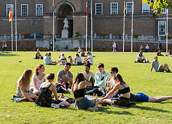 "© Licensed to London News Pictures; 21/09/2020; Bristol, UK. A group of 10 young people sit on College Green. Groups of people, some more than six in number, enjoy the sunshine and hot weather on the last official day of summer in Bristol city centre, amid concerns about a second wave of the covid-19 coronavirus pandemic across the UK, with many areas going into local lock down. From Monday 14 September it was illegal to meet up socially in groups of more than six people, known as the ""Rule of Six"", in order to try and contain the spread of the covid-19 coronavirus pandemic, and police have said they will enforce the law with fixed penalty notices which will increase for repeat offenders. Photo credit: Simon Chapman/LNP."