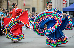 © Licensed to London News Pictures. 30/12/2018. London, UK.Two dancers from Carnaval Del Pueblo, a dance group from across Latin America, perform at a preview ahead of the London New Year's Day Parade. More than 8,000 performers from 26 countries will take part in the parade on 1st January 2019. Photo credit: Rob Pinney/LNP