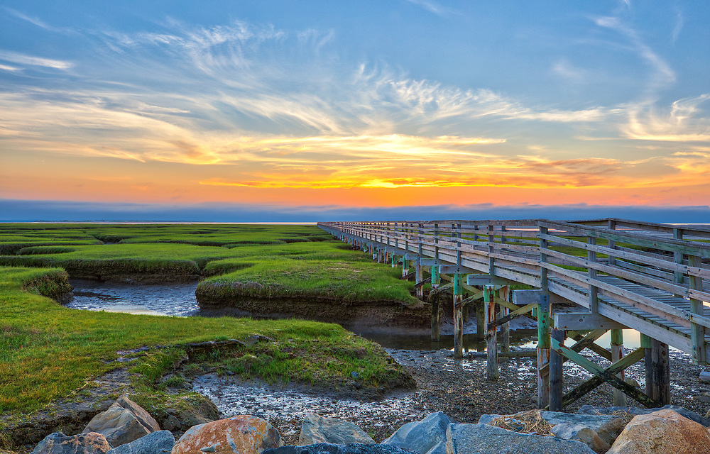 Cape Cod fine art photography of the iconic Grays Beach Boardwalk at Bass Hole with its peaceful view across the salt marsh and Cape Cod Bay, photographed on a beautiful sunset night in Yarmouth Port, MA.<br />   <br /> Cape Cod fine art photography is available as museum quality photography prints, canvas prints, acrylic prints or metal prints. Fine art prints may be framed and matted to the individual liking and decorating needs:<br /> <br /> https://juergen-roth.pixels.com/featured/cape-cod-bass-hole-boardwalk-juergen-roth.html<br /> <br /> All Cape Cod digital photography image licensing is available at www.RothGalleries.com. Please contact Juergen with any questions or request. <br /> <br /> <br /> Good light and happy photo making!<br /> <br /> Juergen