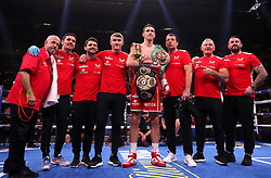 Callum Smith (centre) celebrates his win in the WBA 'Super' World, WBC Diamond, Ring Magazine fight with brothers Liam Smith (centre left) and Paul Smith (right) and training team at Madison Square Garden, New York.