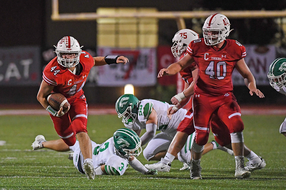 Dylan Sleva #44 of the Moon Tigers carries the ball in the second half during the game against the South Fayette Lions at Tiger Stadium on October 1, 2021 in Moon Township, Pennsylvania.