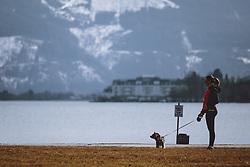 THEMENBILD - eine Frau beim Gassi gehen mit ihrem Hund, aufgenommen am 09. Maerz 2021 in Zell am See, Österreich // a woman walking with her dog, Zell am See, Austria on 2021/03/09. EXPA Pictures © 2021, PhotoCredit: EXPA/ JFK