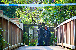 © Licensed to London News Pictures. 08/05/2018. OXFORD, UK.  General view of the scene today (Tue) in Paradise Square following an exchange of gunfire between a man and police yesterday and an armed siege overnight. Only a small cordon remains behind a row of terraced houses. A 24 year old man was arrested at 3am this morning on suspicion of attempted murder. Photo credit: Cliff Hide/LNP