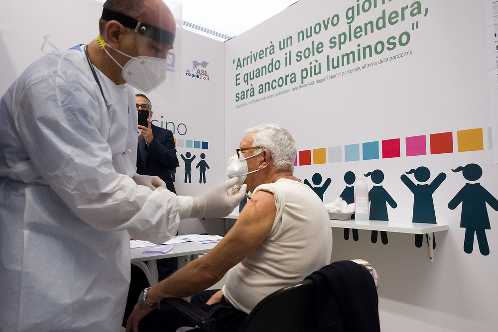 An elderly man receives a dose of the Pfizer-BioNTech COVID-19 vaccine on February 10, 2021 at the Covid Vaccine Center in Bacoli, southern Italy, as part of vaccinations for people over 80.