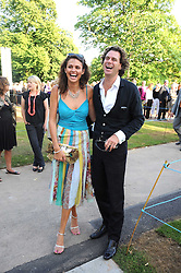 OLIVIA COLE and RICHARD HAINES at a party at the Serpentine Gallery, Kensington Gardens, London to unveil their summer Pavilion designed by Frank Gehry on 20th July 2008.<br /> <br /> NON EXCLUSIVE - WORLD RIGHTS